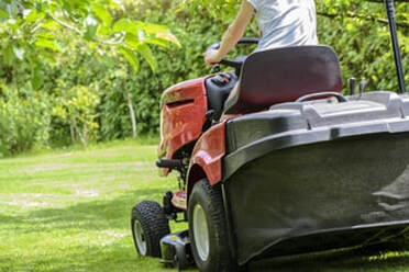 A ridding mower from the back
